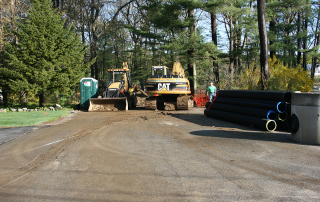 Staging area beginning to install drainage pipe