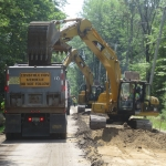 Removing the unsuitable material from road bed, to replace it with NHDOT Spec