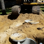 Backfilling the sides of the 2000 Gallon Septic Tank