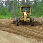 Grading the Subgrade of the Roadway before the base material is spread