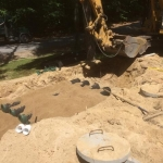 Covering the Advanced Presby Enviro Pipe with Septic Sand